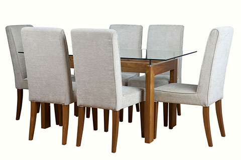 Glass top dining table with fully covered cushion chairs