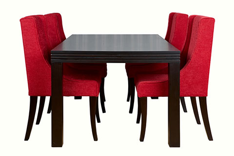 Walnut color dining table with fully covered fabric chairs