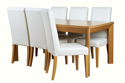 Natural color dining table with fully covered cushion chairs