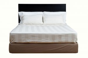 Double bed with wooden rectangular headboard