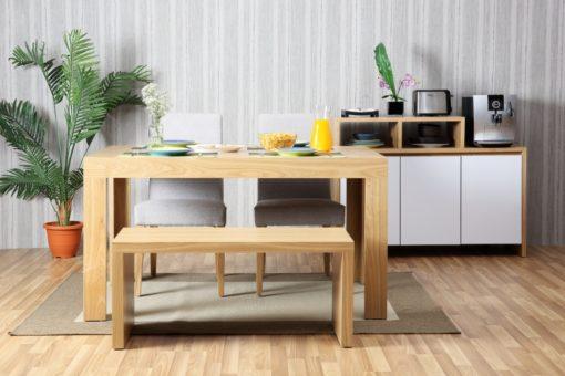 Dining room set up of light color wood furniture